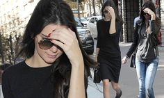 Kendall Jenner swaps the lbd for a jeans and tee combo  with ruby red nails.