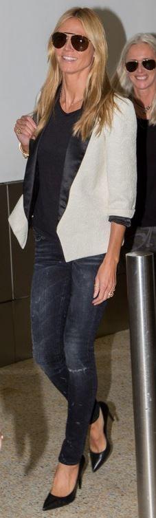 Heidi Klum: Purse – Louis Vuitton  jeans – R13  Shoes – Saint Laurent