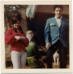 Priscilla and Elvis pose in front of the famous Nativity scene at Graceland, Christmas 1964.Originally posted on loveselvis, now courtesy of loveselvispresley.