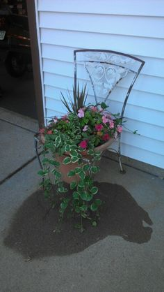 Cast iron chair with planter