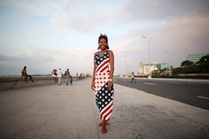 Psychologist Aliuska Garcia, 26, wearing a dress designed with the US flag on the Malecon seafront - Stars and Stripes Havana street fashion