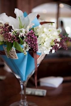 Giant martini glass centerpiece filled with our pew cones graced the bar at our reception.