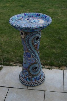 the whole bird bath from the front; vitreous glass tile, stained glass tile, glass gems, on terracotta bowl and pots; height app. 1m426 x 640   180.4 KB   www.flickr.com