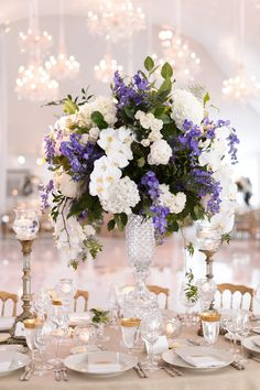 White with a touch of purple #blisschicago #weddings #centerpiece