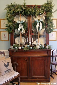 2012 Christmas Home Tour. I love the natural feel to these decorations. The mini village under glass is precious. use lots of greenery