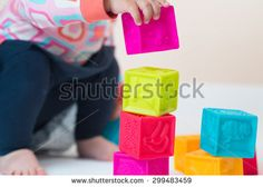 baby playing with colored cubes isolated on the white background