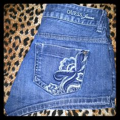 Guess Shorts Blue denim short shorts. Very cute with flower embroidery on the back pockets. Guess Shorts Jean Shorts