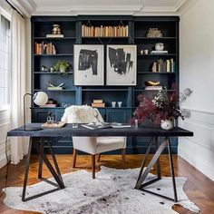 Everything is right where you need it in this modern home office outfitted with handsome navy-coated built-ins.C2 Paint's Espionage (C2_742)Make a wall of bookshelves or another piece pop with our quick-and-easy paint upgrades for furniture.