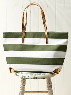 Carry summer's essentials in style with this striped canvas tote from Banana Republic.