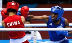 Nicola Adams wins historic first women's Olympic boxing gold.