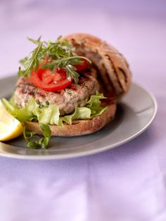 the best tuna burger With zingy lemon and herbs These meaty tuna burgers are great for the barbecue and a tasty change from beef burgers Burger Recipes, Fish Recipes, Seafood Recipes, Great Recipes, Favorite Recipes, Healthy Recipes, Grilling Recipes, Healthy Food, Jamie Oliver