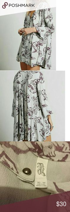 Free People Cloud tunic dress GUC third photo shows a slight issue..love the bold 💐!  color is true to first two photos. Price will reflect for the small flaw..Size states XS but could fit small as a tunic. Free People Dresses High Low