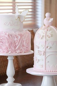.Love these two pretty cakes and milk bottle pedastals