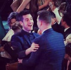 Dan Smith of Bastille, embracing Sam Smith, even after Sam Smith won the Grammy they were competing for.