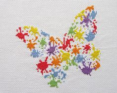Fun cross stitch pattern of a butterfly made up of splashes of splattered paint. A bright and modern stitch. This design is available as a cross stitch kit here: https://www.etsy.com/uk/listing/545049166/ • Stitch count: 80 wide x 75 high • Approximate size on 14 count aida: