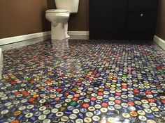 I wanted something different and unique in my basement bathroom.  I started saving caps through bars and friends and here are the results!  The floor is thin se…