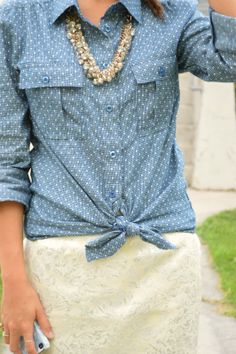 Chambray polka dots top knotted over a cream lace skirt (The necklace is a great shape too)