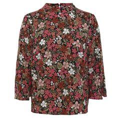Virágmintás blúz, ami ideális viselet az irodába. Ceruzaszoknyával és magas sarkú cipővel párosítsd.