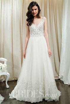 A V-neck, A-line wedding dress by @badgleymischka with a jeweled bodice | Brides.com