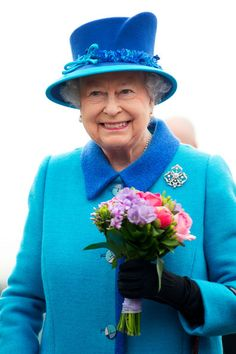 Queen Elizabeth II holds a posy of flowers during an official visit to Cotts Farm Equine Hospital, Narbeth on April 29, 2014 in Narbeth, Wales. The Cotts Equine Hospital is a purpose-built facility offering veterinary equine care.