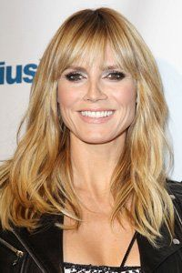 We love Heidi Klum's new fringe. Not too blunt or too whispy, the slightly separated sections make for a care-free, easy breezy look that's reflected in her loose waves too.