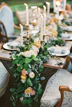 A lush floral garland makes a spectacular table runner