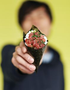 A sample of temaki (hand-rolled Japanese sushi cones) from Yoobi. Photography courtesy of We Heart. #photography #yoobi #temaki #japanese #cuisine #food #sushi #cones #hands