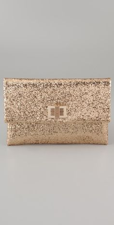The glitter clutch by Anya Hidmarch is the perfect bag to keep a tube of lip gloss, phone and other little must haves on hand.  Perfect to use on your wedding day but can definitely be used to accent your cocktail dresses afterwards.