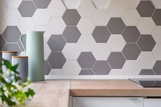A simple and non-permanent tip for decorating your rental home like you own it; peel and stick backsplash tiles! ⠀ ⠀ Search your preferred home improvement store for Diy Home Decor Bedroom, Diy Home Decor On A Budget, Painting Bathroom Tiles, Paint Tiles, Grey Wall Tiles, Kitchen Splashback Tiles, Grey Kitchens, Kitchen Grey, Hexagon Tiles