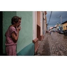 I was in Trinidad de Cuba last April and there was a summer storm one afternoon photographer Gianfranco Gentile(@stop_and_search) remembers of this picture Once the rain had stopped I decided to head out with my camera to catch the incredibly beautiful saturated colors against the unusually gray sky. When I spotted this old local lady having a smoke totally absorbed in her thoughts I just saw a wonderful tableau in front of me. Moreover my mind went immediately to Serge Gainsbourg whom she…