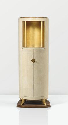 DOMINIQUE ANDRÉ DOMIN & MARCEL GENEVRIÈRE - MEUBLE VITRINE, SHAGREEN, GILT WOOD AND GILT BRONZE - display cabinet, c.1928.