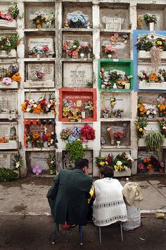 Graveyard visit at the Day of the Dead celebration in Leon, Guanajuato, Mexico. The graves are above ground and burial rights are for a limited time. Each square represents a grave. On November 2, family members visit the departed ones, bring flowers and clean up the graves.