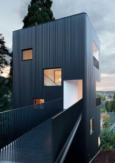 Perfect for a tough-to-build-on hillside.  modern-tower-house-bw