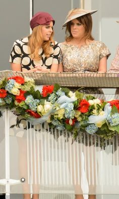 The royal sisters Princess Beatrice (L) and Princess Eugenie (R) appeared deep in conversation at Epsom today, 1st of June 2013