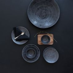 Pentik Kivi / Kallio Dinnerware The Kivi (Rock) collection by Anu Pentik brings a natural, neo-primitive playfulness to the setting. Dark in color like stone, the handcrafted ceramics are adorned with swirled detailing like that of a. Rock Collection, Dinnerware, Plates, Ceramics, Small Things, Stone, Tableware, Kitchen, Inspirational