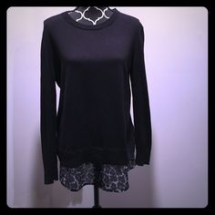 Michael Kors Sweater Gorgeous black Michael Kors sweater with sheer part at bottom to give the appearance of a layered look. Very flattering and looks great on! Worn a couple times but still in good condition! MICHAEL Michael Kors Sweaters