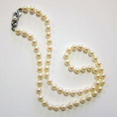 This vintage circa 1950's Mikimoto saltwater Akoya pearl necklace is simply lovely, and I do know why these pearls are so highly revered and coveted.  The luster on this strand of cultured pearls is luscious with its striking creamy pink hue.