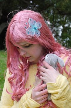 Fluttershy cosplay from My Little Pony Friendship is Magic.   Fluttershy and Angel  by ~nessabutterfly on deviantART
