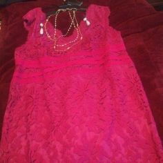 Rose  dress by Tadashi Shoji 💞REDUCED $25 💞 The perfect dress for a wedding or any special occasion . This lovely dress is by Designer Tadashi Shoji. The color is Rose . It has a lace top with a attached under dress. It is sleeveless , zips up the back. The dress has some stretch. Length 40' top to bottom. Bust arm pit to armpit 26'. Waist 24' it is lined has a back zipper . The dress is NWTS. Size 22W💞 Tadashi Shoji Dresses Midi