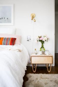 To keep a light and airy feel in the bedroom, pick furniture with peg or bentwood legs, as opposed to blocky, solid pieces that go to the floor. We love this little midcentury nightstand paired with the bright Southwestern-inspired lumbar pillow on the bed.