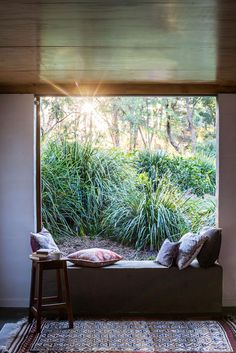 Attached to the garage, the studio is a calming space. Like the rest of the home, it's firmly rooted in the garden, where the extensive…