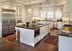 darker counters with white kitchen, different counter on island