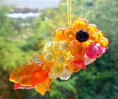 Hey, I found this really awesome Etsy listing at https://www.etsy.com/listing/78091553/sun-catcher-suncatcher-beaded-ornament
