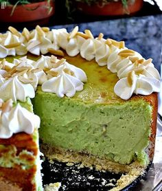 Pistachio Cheesecake: 3 packages of cream cheese, softened 1 can ounces) sweetened condensed milk 2 packages ounces each)instant pistachio pudding mix 5 eggs garnish with whip cream and almond slivers ( No Bake Desserts, Just Desserts, Delicious Desserts, Dessert Recipes, Yummy Food, Pistachio Cheesecake, Cheesecake Recipes, Pistachio Pudding Cake, Pistachio Recipes