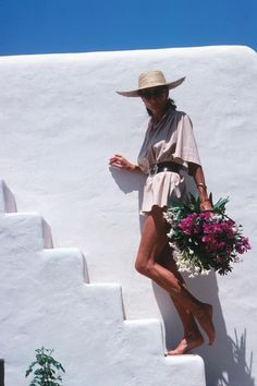 IN BLOOM | French style icon Viscountess Jacqueline de Ribes on the terrace of her...