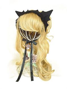 """Antique Beast's official name for it is the """"black cat"""" headdress but it looks more like a bat to me."""