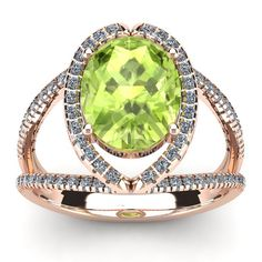 3 Carat Oval Shape Peridot and Halo Diamond Ring In 14 Karat Rose Gold: This stunning gemstone and diamond ring features one 10x8mm oval…