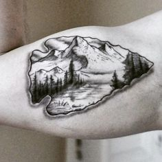 blackwork arrowhead tattoos