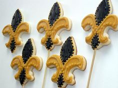 fleur de lis sugar cookies on sticks.