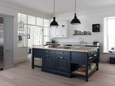 light floor, dark iunits (charcoal) with skirting, and light wooden worktop